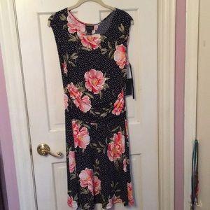 Dress. Floral and polka dot patterned, above knee